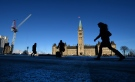 People make their way to Parliament Hill in Ottawa on Monday, January 26, 2015. (Sean Kilpatrick/THE CANADIAN PRESS)