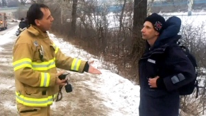 Capt. Wayne Grotski of Edmonton Fire Rescue lectures a young man about the dangers and 'stupidity' of venturing onto thin ice.