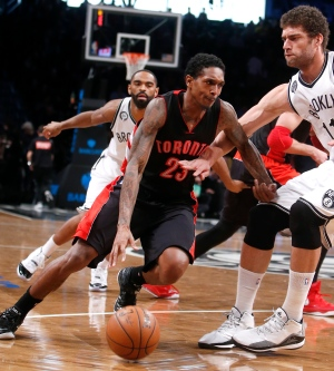 Toronto Raptors' Lou Williams (23) drives against Brooklyn Nets' Brook Lopez during the second quarter of an NBA basketball game Friday, Jan. 30, 2015, in New York. (Jason DeCrow/AP Photo)