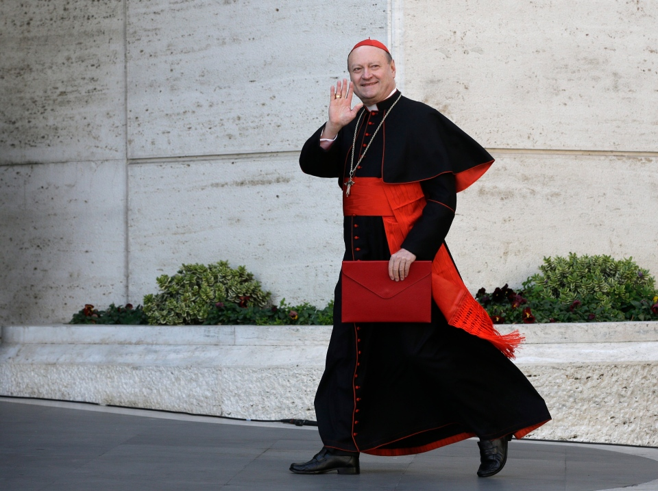 In this March 4, 2013 file photo Italian Cardinal Gianfranco Ravasi waves to reporters as he arrives for a meeting, at the Vatican. (AP Photo/Andrew Medichini)