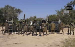 In this image taken from video released by Boko Haram Oct. 31, 2014, shows Abubakar Shekau, centre, the leader of Nigeria's Islamic extremist group denying agreeing to any cease-fire with the government and saying more than 200 kidnapped schoolgirls all have converted to Islam and been married off. (AP / Boko Haram)