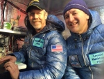 This Jan. 8, 2015 photo provided by Tami Bradley-Two Eagles Balloon Team, shows pilots from left, Troy Bradley of Albuquerque, N.M., and Leonid Tiukhtyaev of Russia, before they lift off in a gas balloon in Saga, Japan. The Two Eagles pilots have traveled farther and longer in a gas balloon than anyone in history. (AP/Tami Bradley-Two Eagles Balloon Team)