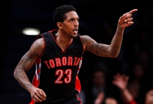 Toronto Raptors' Lou Williams (23) reacts after scoring against the Brooklyn Nets during overtime of an NBA basketball game Friday, Jan. 30, 2015, in New York.Toronto defeated Brooklyn 127-122 in overtime. (AP/Jason DeCrow)