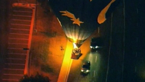 Balloon carrying bride and groom makes emergency l