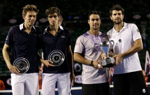Italy's Simone Bolelli, right, and Fabio Fognini, second right, hold the trophy, with runners-up France's Pierre-Hugues Herbert, second left, and Nicolas Mahut, far left, in the men's doubles final at the Australian Open tennis championship in Melbourne, Australia, Saturday, Jan. 31, 2015. (AP/Bernat Armangue)