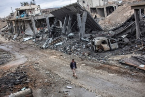 The Islamic State group has acknowledged for the first time that its fighters have been defeated in the Syrian town of Kobani and vowed to attack the town again. <br><br>  A Syrian Kurdish man walks among the rubble in the Syrian city of Ain al-Arab, also known as Kobani, Friday, Jan. 30, 2015. (AP)