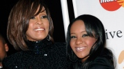 In this Feb. 12, 2011, file photo, singer Whitney Houston, left, and daughter Bobbi Kristina Brown arrive at an event in Beverly Hills, Calif. The daughter of late singer and entertainer Whitney Houston was found Saturday, Jan. 31, 2015, unresponsive in a bathtub by her husband and a friend and taken to an Atlanta-area hospital. The incident remains under investigation. (AP / Dan Steinberg)