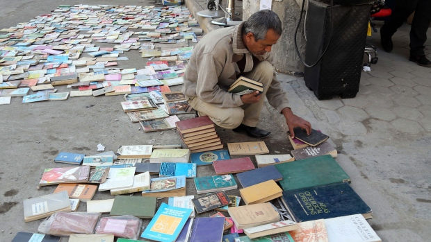 Iraqi man looks at books on al-Mutanabi Street
