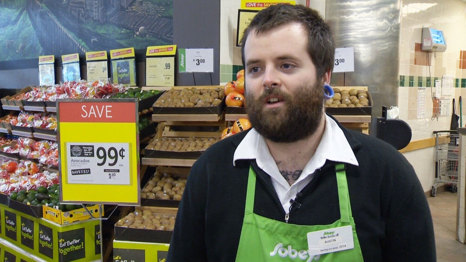 A photo of Austin MacNeill, a cashier at a Halifax Sobey's, helping an elderly customer walk home on an icy sidewalk has gone viral. (File Photo)