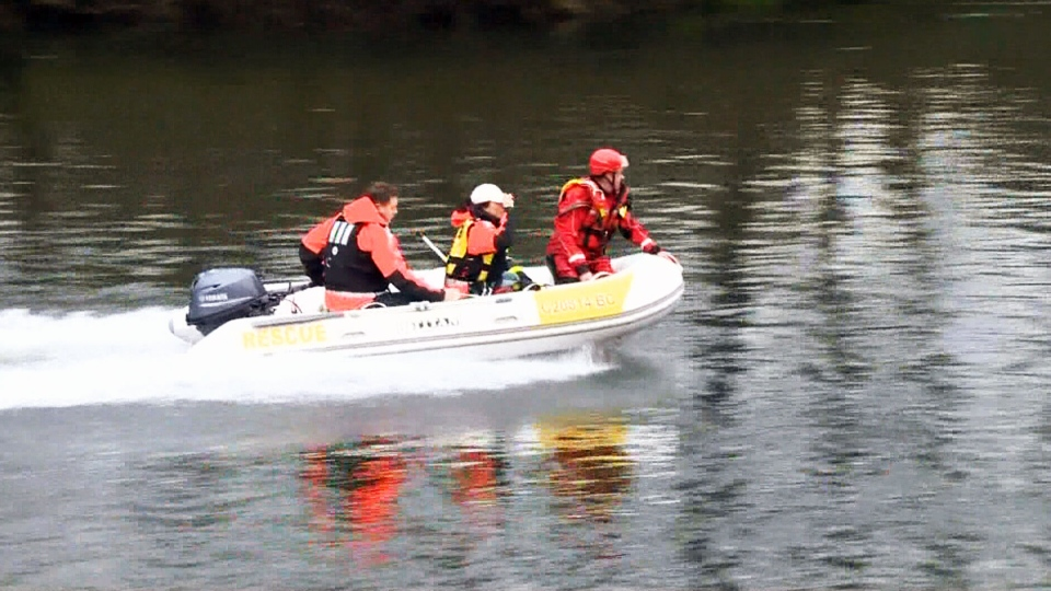 Emergency crews search frantically for a mother and child spotted adrift in a raging river near Courtenay, B.C.