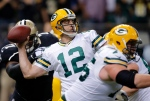 In this Oct. 26, 2014 file photo, Green Bay Packers quarterback Aaron Rodgers throws a touchdown pass during the first half of an NFL football game against the New Orleans Saints in New Orleans. Rodgers has won his second Associated Press NFL Most Valuable Player award. (Bill Haber / AP Photo)