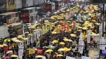 Thousands of pro-democracy activists take part in a democracy march to Central, demanding for universal suffrage in Hong Kong Sunday, Feb. 1, 2015. (AP / Kin Cheung)