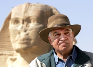 In this file photo taken March 11, 2007, Zahi Hawass, Egypt's former top antiquities official, poses in front of the ancient Sphinx in Giza, Egypt. (AP Photo/Amr Nabil)