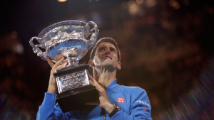 Novak Djokovic of Serbia poses with the trophy after defeating Andy Murray of Britain in the men's singles final at the Australian Open tennis championship in Melbourne, Australia, Sunday, Feb. 1, 2015. (AP / Bernat Armangue)