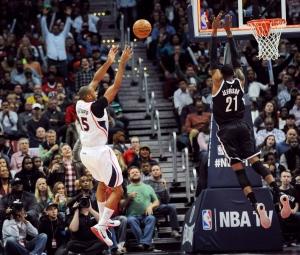 Atlanta Hawks center Al Horford (15) shoots as Brooklyn Nets forward Cory Jefferson (21) defends during the second half of an NBA basketball game on Wednesday Jan. 28, 2015, in Atlanta. Atlanta won 113-102. (AP / John Amis)