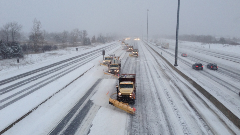 Snowplows clear Highway 401 in Toronto on Monday, Feb. 2, 2015. (Zuraidah Alman / CTV Toronto)