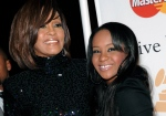 Singer Whitney Houston, left, and daughter Bobbi Kristina Brown arrive at an event in Beverly Hills, Calif., on Feb. 12, 2011. (AP / Dan Steinberg, File)