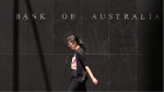 A woman walks past the Reserve Bank of Australia in Sydney. Australia's central bank cut its benchmark interest rate to a record low of two per cent in a bid to jolt an economy weighed down by falling commodity prices on Tuesday, May 5, 2015. (AP / Rick Rycroft)