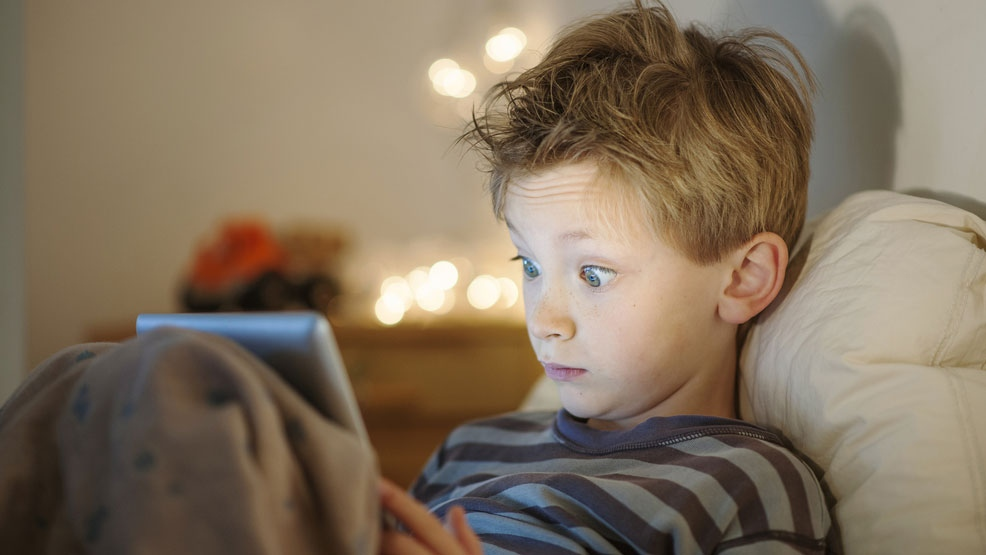 Child with a tablet computer