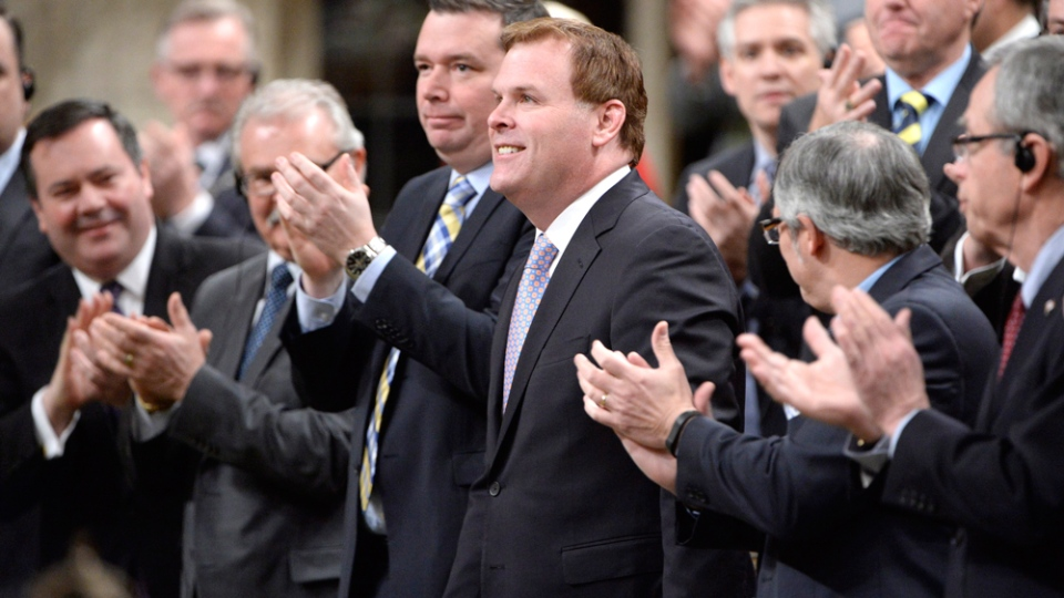 John Baird receives a standing ovation while announcing his resignation in the House of Commons in Ottawa on Tuesday, Feb. 3, 2015.  (Adrian Wyld / THE CANADIAN PRESS)