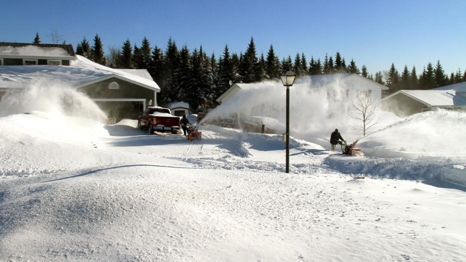 Three people with snow blowers clear snow in Saint John, N.B., Tuesday, Feb. 3, 2015. (Mel Small / MyNews)