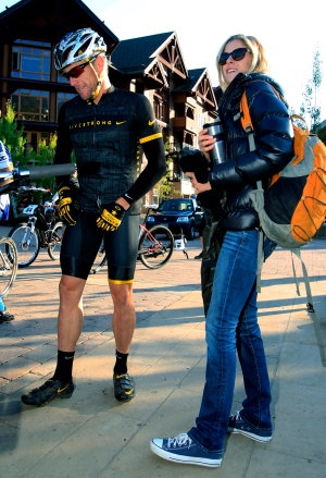Lance Armstrong, left, prepares to take part in the Power of Four mountain bicycle race, as his girlfriend Anna Hansen looks on, in Snowmass Village, Colo., on Aug. 25, 2012. (AP / David Zalubowski)