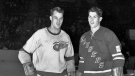 In this Jan. 3, 1951, file photo, Detroit Red Wings' Gordie Howe, left, and his brother, New York Rangers' Vic Howe, pose for a photo before an NHL hockey game at Madison Square Garden in New York. (AP Photo/File)