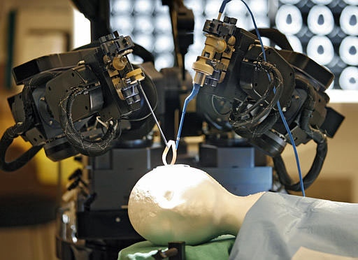 The University of Calgary unveiled in Calgary on Tuesday, April 17, 2007 the world's first MRI-compatible robot for brain surgery. (CP / Jeff McIntosh)