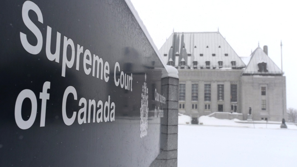 The Supreme Court of Canada in Ottawa on Friday, Feb. 6, 2015. The SCC has unanimously struck down the ban on providing a doctor-assisted death. (Sean Kilpatrick / THE CANADIAN PRESS)