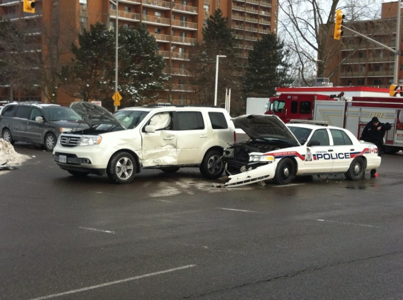 A police cruiser and and SUV were involved in a collision in northeast London, Ont. on Friday, Feb. 6, 2015. (Gemma Peters / CTV London)
