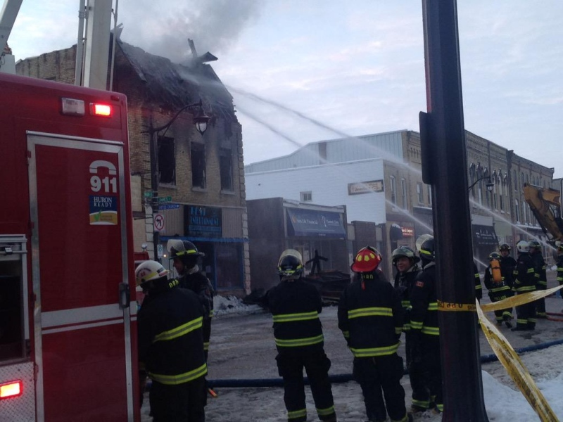 Fire crews continue to douse hotspots after a fire in downtown Exeter, Ont. on Friday, Feb. 6, 2015. (Kelda Yuen / CTV London)