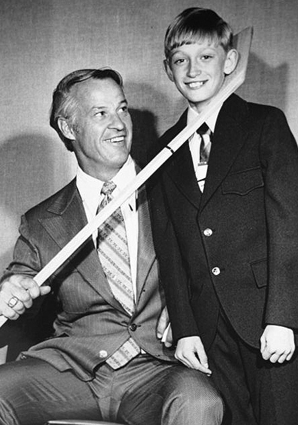 Wayne Gretzky figures there is no photograph fans ask him to sign more often than the one of him as a smiling preteen beside his idol Gordie Howe, who is playfully hooking a hockey stick around the future Great One's neck. (Image courtesy: Brantford Expositor)