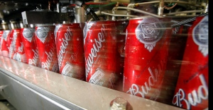 Budweiser cans run through a filling machine at the Anheuser-Busch brewery in the Van Nuys area of Los Angeles in this March 2011 file photo. (AP / Reed Saxon)