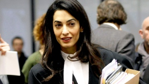 Amal Clooney arrives at the European Court of Human Rights in Strasbourg, eastern France, Wednesday, Jan. 28, 2015. (AP / Christian Lutz)