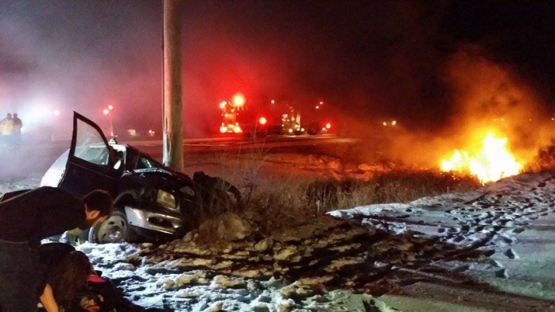 Three passersby pulled a man from a flaming wreck after a two-vehicle crash on Highway 59 that sent three people to hospital Saturday night. (Photo courtesy of Jeff Hazlehurst)
