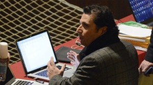 Francesco Schettino sits in front of two laptops during a pause of his trial at the Grosseto court, Italy, on Feb. 9, 2015. The trial is expected to bring a verdict this week. (AP / Giacomo Aprili)