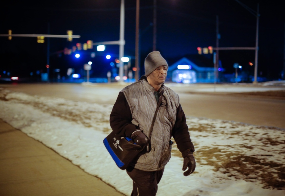 James Robertson, 56, of Detroit, makes his way home after working his shift at Schain Mold & Engineering in Rochester Hills on Jan. 9, 2015. (AP / Detroit Free Press, Ryan Garza)
