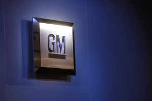 The General Motors logo is shown at the North American International Auto Show in Detroit in this December 2009 file photo. (AP / Paul Sancya)