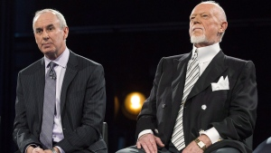 Ron MacLean (left) sits with Don Cherry as Rogers TV unveils their team for the station's NHL coverage in Toronto on Monday, March 10, 2014. (Chris Young / THE CANADIAN PRESS)