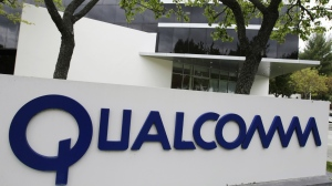 The corporate sign of Qualcomm Inc. is seen in front of its office in Santa Clara, Calif on April 18, 2011. China fined chipmaker Qualcomm 6 billion yuan ($975 million) in the biggest of a wave of anti-monopoly penalties that have rattled foreign companies. (AP / Paul Sakuma)