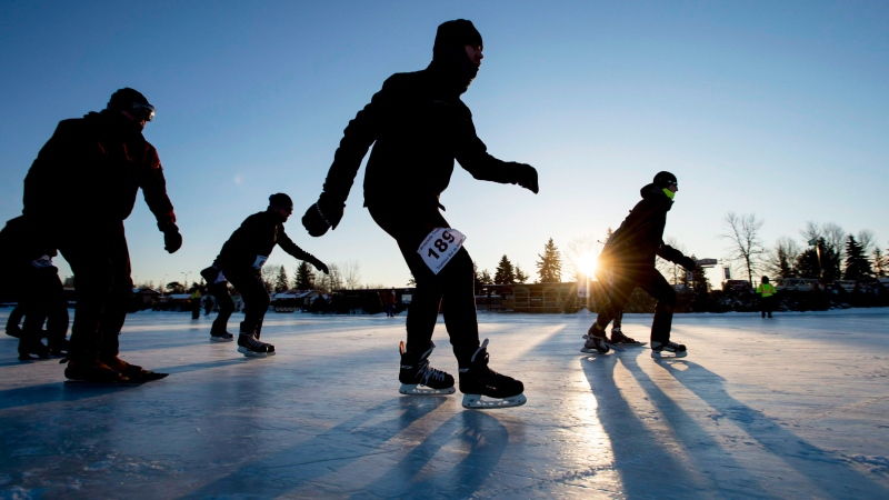 Skaters make their along the Rideau Canal Skateway during the 32nd annual Winterlude Triathlon in Ottawa on Saturday, Jan. 31, 2015. (Justin Tang / THE CANADIAN PRESS)