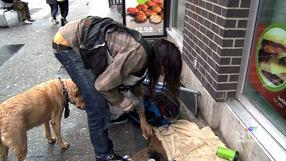Vancouver homeless man Grant Faithful outside the Tim Hortons outlet with his dog.