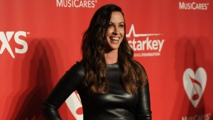 Alanis Morissette arrives at the 2015 MusiCares Person of the Year event at the Los Angeles Convention Center in Los Angeles, on Friday, Feb. 6, 2015. (Richard Shotwell / Invision)