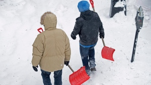 Snow shovellers head to work as a major winter storm hits Halifax on Tuesday, Jan. 27, 2015.  (Andrew Vaughan / THE CANADIAN PRESS)