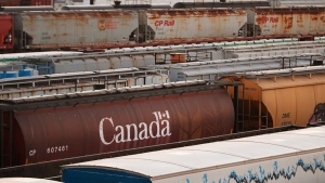 Rail cars wait for pickup in Winnipeg, Sunday, March 23, 2014. THE CANADIAN PRESS/John Woods