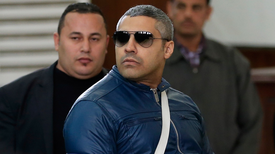 Canadian Al-Jazeera English journalist Mohamed Fahmy arrives to talk to the judge in a courthouse near Tora prison in Cairo, Egypt, Thursday, Feb. 12, 2015. (AP / Hassan Ammar)