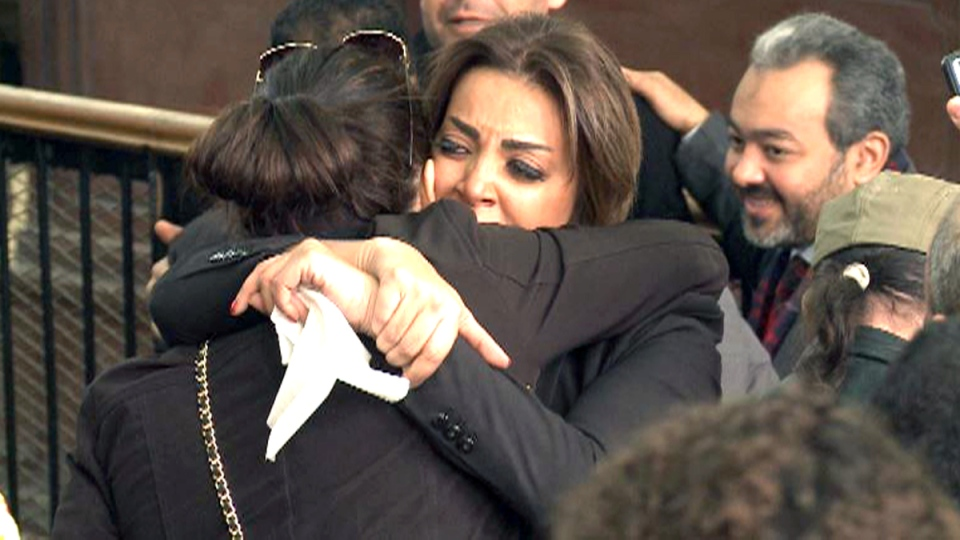 Marwa Omara, the fiancee of Al-Jazeera English journalist Mohammed Fahmy, reacts to Fahmy's release on bail in a courthouse near Tora Prison in Cairo, Egypt, Thursday, Feb. 12, 2015. (John Mees / CTV News)