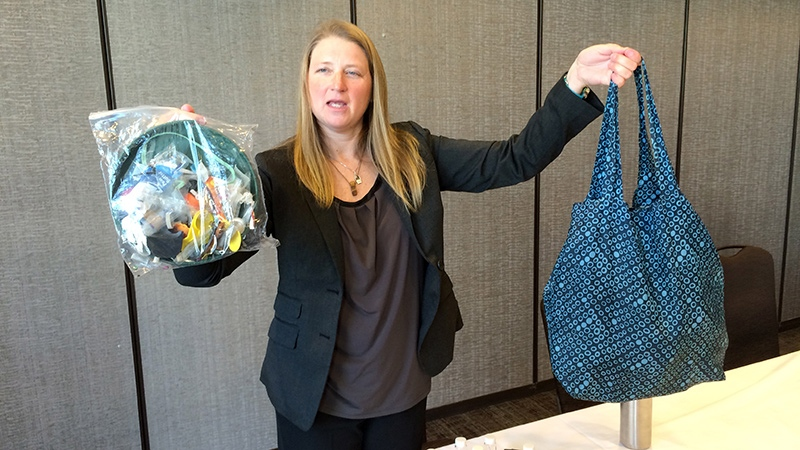 Jenna Jambeck, an environment engineering professor at the University of Georgia, holds a shopping bag filled with plastic trash from the ocean, right, and a plastic baggie with trash collected last fall from a clean up at Panama Beach, Fla., Thursday, Feb. 12, 2015, at the AAAS (American Association for the Advancement of Science) conference in San Jose, Calif. . (AP /Seth Borenstein)