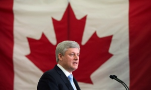 Prime Minister Stephen Harper addresses families of victims of repeat violent offenders, Thursday, February 12, 2015 in Victoriaville, Que. (THE CANADIAN PRESS/Paul Chiasson)
