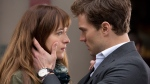 """In this image released by Universal Pictures and Focus Features, Dakota Johnson, left, and Jamie Dornan appear in a scene from """"Fifty Shades of Grey."""" (Universal Pictures and Focus Features)"""